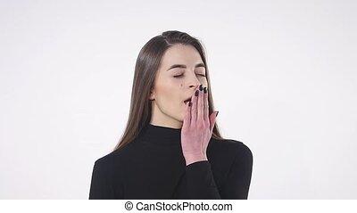 Beautiful woman yawns of boredom on white background.