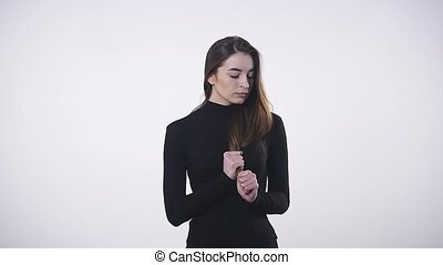 worried woman over white background.