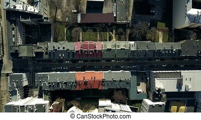 Aerial shot of streets and roofs of dwelling houses in...