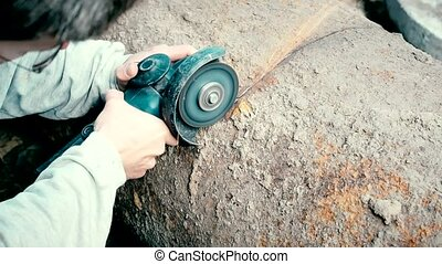Time lapse of cutting big old rusted iron pipe with an...