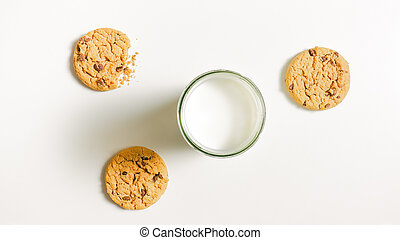 Cookies and a glass of milk on a table - Three round friable...