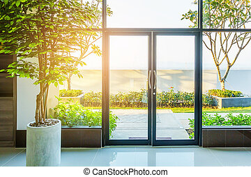 Transparent door in modern office, glass door of the office building.