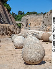 Ancient stone cannon ball in the fosse of the old Rhodes...