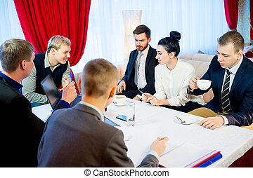 Business meeting in a restaurant - Some businessmen are...