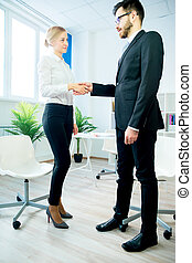 Manager and candidate shaking hands