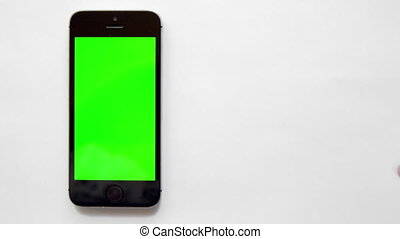 smartphone with green screen, hand clicks and smacks