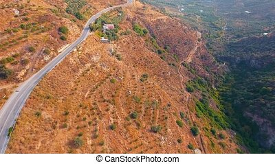 flying above serpentine road in mountains at Crete Island