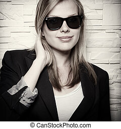 sepia toned portrait of stylish casual girl with sunglasses
