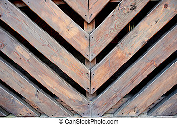 Oblique wooden slats. Bonded at an angle of 45 degrees. Fence, fencing