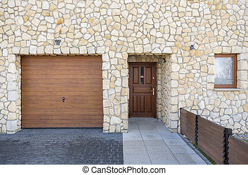 Home entrance and garage - Modern stonework front home...
