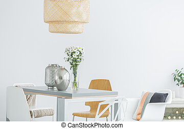 Communal table with flowers in white modern loft