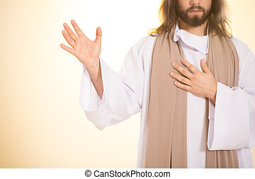 Jesus holding hand on heart - Jesus holding one hand on...