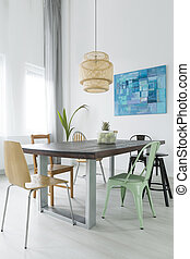 Dining room with trendy lamp