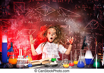 girl in laboratory - Funny little girl doing experiments in...