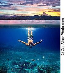 Underwater shoot of a young man snorkeling in a tropical sea...