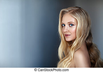 Beauty portrait of nordic natural blonde woman on dark...