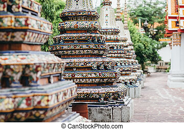Beautifull decorated stupas and pagoda in Wat Pho temple,...