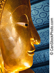 Close up face of big reclining buddha at Wat Pho temple in...