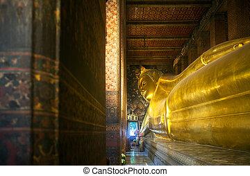 Big reclining buddha at Wat Pho temple in Bangkok, Thailand