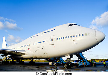 Air travel - Jumbo plane in airport - Air travel - A parked...