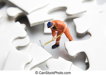 Digging through the confusion - Worker figurines placed with...