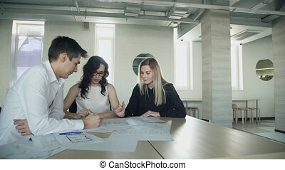 Business meeting of women man sitting inside office