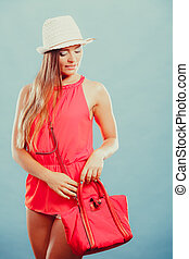 Fashion woman in hat and red shirt with handbag. - Cute...