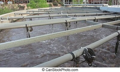 Low angle shot of wastewater treatment tank - Shot of Low...