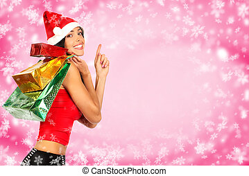 Christmas shopping smiling Santa woman Over red background...