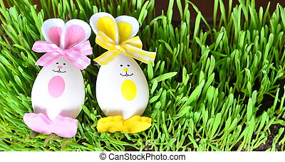 Colored easter eggs bunny on grass