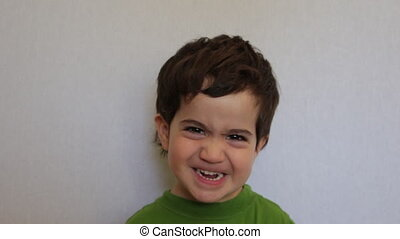 Kid make funny and angry faces - Shot of Kid make funny and...