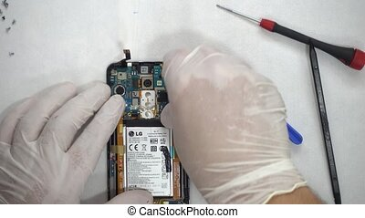 Fixing smartphone by tech guy - Smartphone at repair lab
