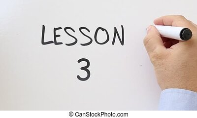 Lesson 3 written on whiteboard - Whiteboard writing business...