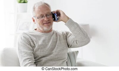 happy senior man calling on smartphone at home 98 -...