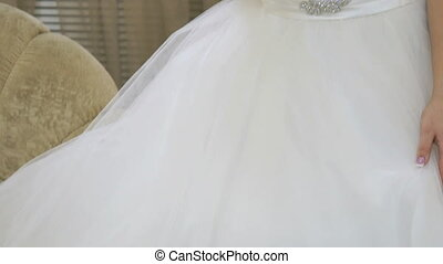 Bride dressed white dress holding a bridal bouquet
