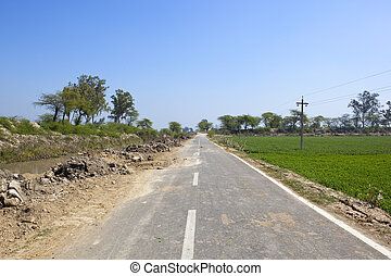 a punjabi road and river - a rural highway with a river and...