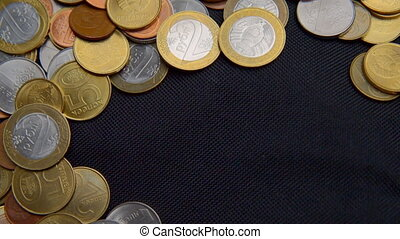 Belarusian coins on black background.