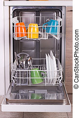 Dishware in dishwasher - Close up of colorful dishware in...