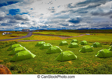 Boy Scout Campground in Iceland. Green tent on a grassy...