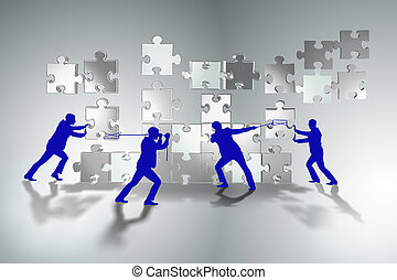 Business concept of teamwork with puzzle pieces