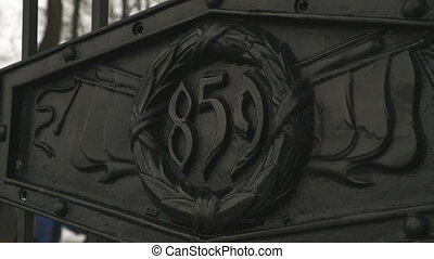 Entrance metal gate with inscription 859. Close-up -...