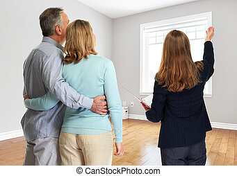 Senior couple with realtor - Realtor broker woman showing...
