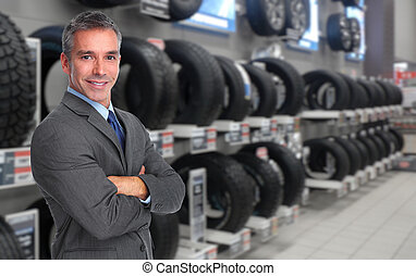 Car dealer man - Handsome Car dealer man over tire shop...