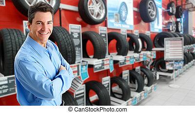 Car dealer man - Handsome Car dealer man over tire shop...