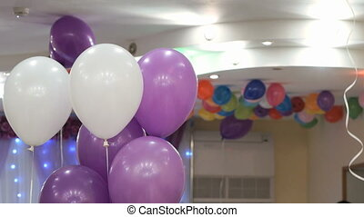 Inflatable purple, white balloons at wedding party -...