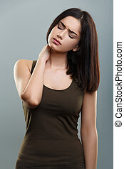 Neck pain - Young woman with neck pain