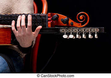 nyckelharpa's scroll, headstock and pegbox details, concept...