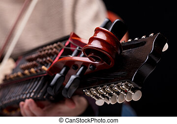 nyckelharpa's scroll detail of its headstock - ancient...