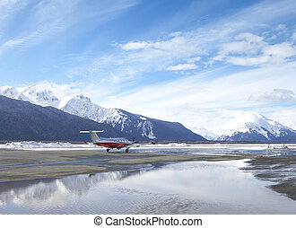 Airport with plane in Alaska - Small passenger plane at the...