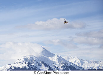 Helicopter over mountains - Helicopter over mountain peaks...